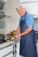 Senior Man Cutting Vegetables